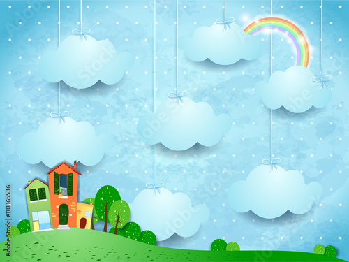 Surreal landscape with hanging clouds and homes