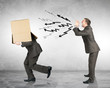 Business boss shouting to employee with box
