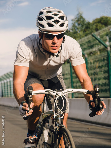 Cyclist pedaling on a racing bike outdoor Canvas Print