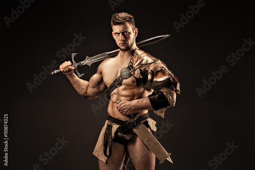 Foto  Portrait of angry warrior in leather clothes with swords