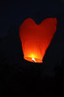 Red heart-shaped chinese lantern in the  sky