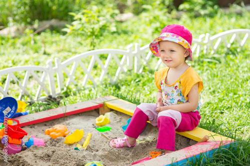 Fotografie, Obraz  Baby girl playing in a sandbox