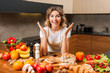 pretty housewife looking at lot of food on kitchen table