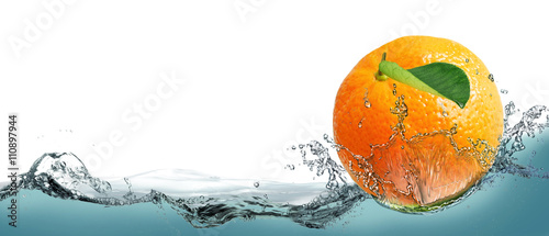 The fruit of a ripe tangerine on a background of splashing water. Wallpaper Mural