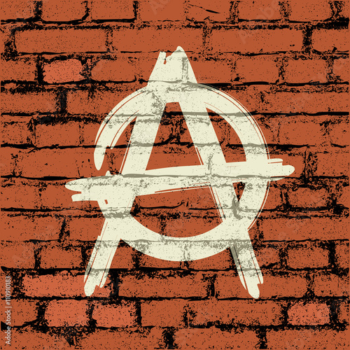 Fotografia anarchy sign on brick wall