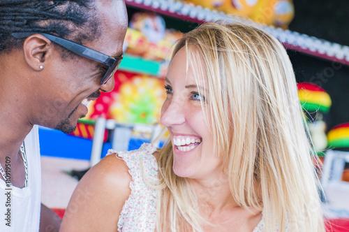 Papiers peints Attraction parc Multi ethnic mature couple laughing at amusement park