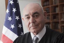 Portrait Of Senior Male Judge
