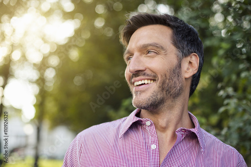 Handsome smiling mature man on street