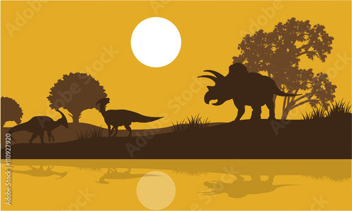 Photo Silhouette of triceratops and parasaurolophus