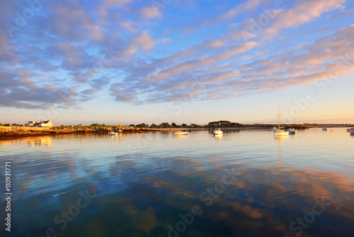 Sunset sea view of yachts and boats in Lilia bay in Brittany, Fr