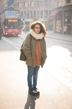 Portrait Of Young Female Commuter On Street