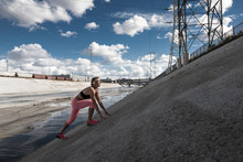 Female Runner Moving Up Steep River Aqueduct, Los Angeles, California, USA