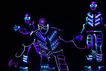 Fototapeta dance team in costumes of the LEDs