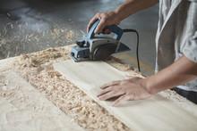 Carpenter Cutting Wood Plank In Factory, Jiangsu, China
