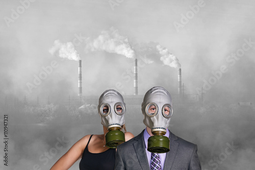 People wearing gas mask on factory background Poster
