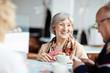 Leinwandbild Motiv Positive granny with her friends