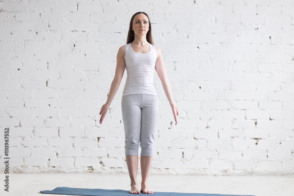 Fototapeta Attractive fit young woman doing Mountain pose in white loft