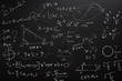 Teacher Hand drawn mathematics on chalkboard.