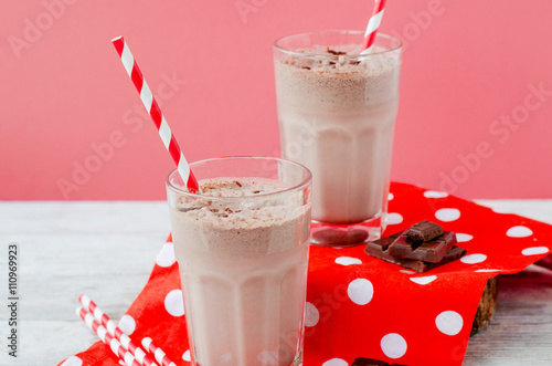 Staande foto Milkshake summer cooling drink, chocolate milkshake with cocoa and ice cream on a wooden background