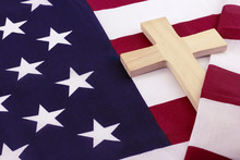 Wooden Cross Wrapped In American Flag