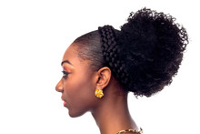 Profile View Of A Attractive Female With Hair Bun And Braids.