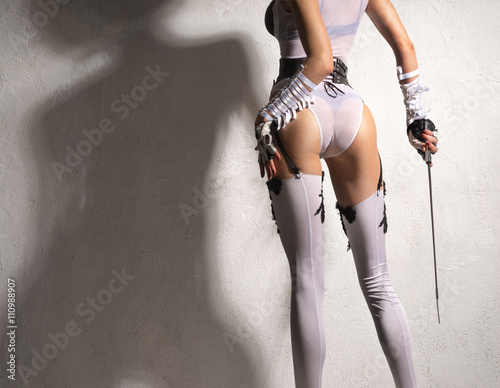Fotografia  Woman with beautiful ass in white lingerie, gloves