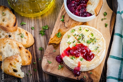 Baked camembert with cranberry sauce and thyme