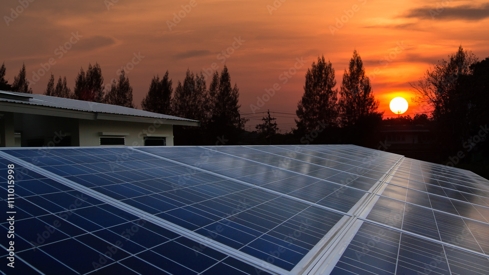 Fototapety, obrazy: Solar panel with sunrise, rooftop