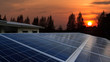 Solar panel with sunrise, rooftop