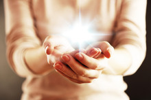 Light In Hands.  Concept Of Ta...