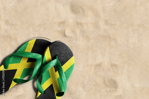 Foto  Thongs with flag of Jamaica, on beach sand