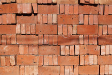A Organized Pile Of Loose Red Bricks Stacked On Top Of Each Other