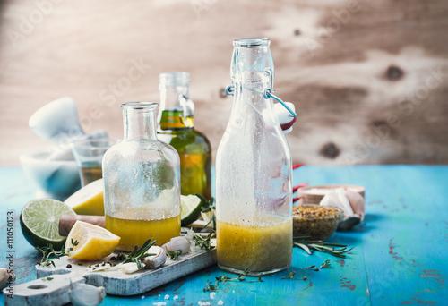 Fotografie, Obraz Vinaigrette and ingredients, salad dressing with oil, vinegar