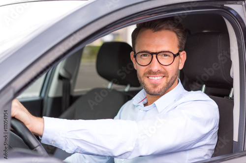 obraz dibond Young attractive man driving his car