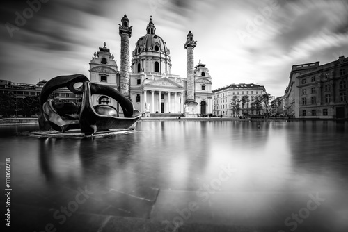 Garden Poster Vienna View on st. Charles's church on Karlsplatz in Vienna. White and black image with long exposure technic with blurred clouds and glossy water.