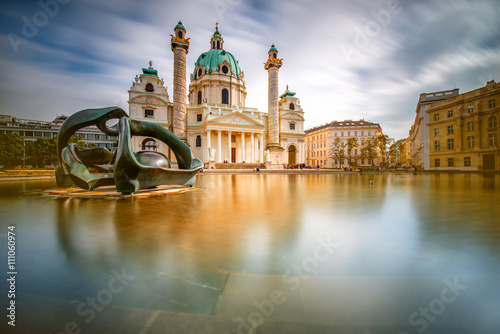 Fotobehang Wenen View on st. Charles's church on Karlsplatz in Vienna. Long exposure technic with blurred clouds and glossy water
