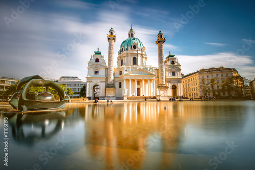 Wall Murals Vienna View on st. Charles's church on Karlsplatz in Vienna. Long exposure technic with blurred clouds and glossy water