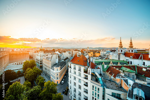 Canvas Print Panoramic cityscape view on Vienna city with Mariahilfer church towers on the su