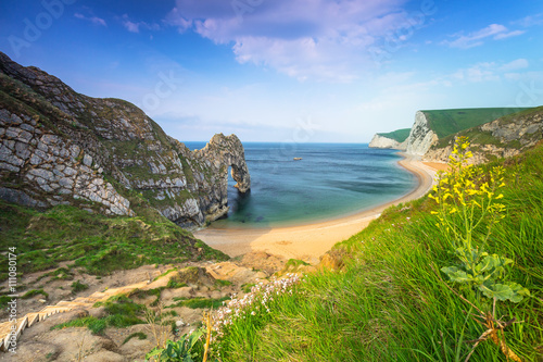 In de dag Kust Durdle Door at the beach on the Jurassic Coast of Dorset, UK