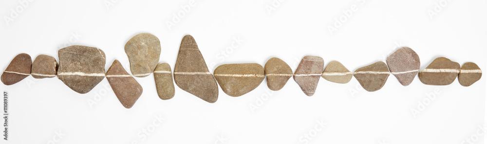 Fototapeta Linie auf Steinen als Symbol für Zen