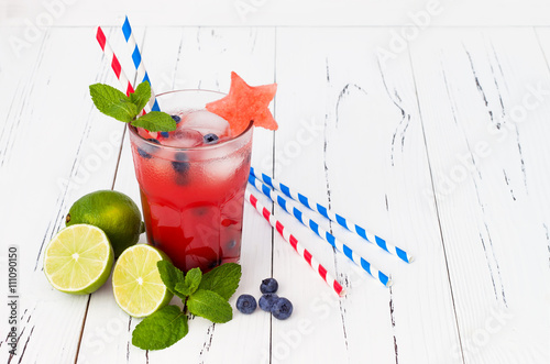 Spoed Foto op Canvas Opspattend water Watermelon blueberry mojito. Patriotic drink cocktail for 4th of July party
