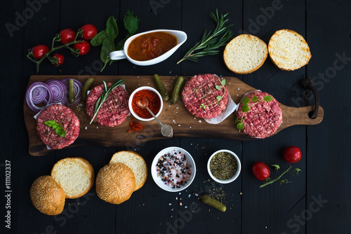 Fotografering  Ingredients for cooking burgers
