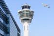 Leinwanddruck Bild - Munich international airport control tower and departing taking off