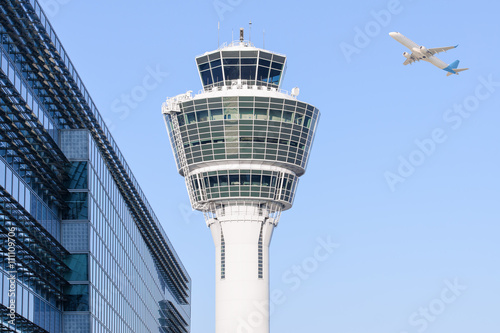Fotobehang Luchthaven Munich international airport control tower and departing taking off