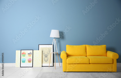 Room Interior With Yellow Sofa On Blue Wall Background Buy This