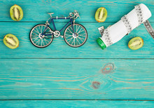 Sport Concept -  Bicycle Model, Bottle Of Water, Kiwi, Centimeter