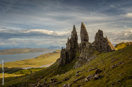 Poster Taupe Old Man of Storr rocks with cloudy sky, Isle of Skye, Scotland