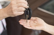 people's hand give and get car key with car background