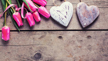 Bright Pink Spring Tulips  And Two Decorative Hearts