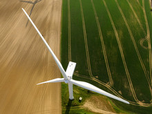Aerial View Of A Wind Turbine In A Agriculture Field